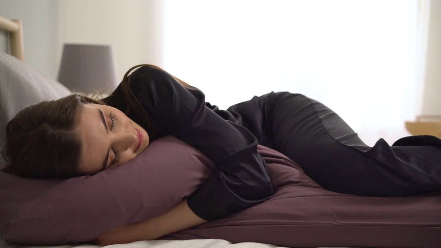 Woman sleeping with a Body Pillow