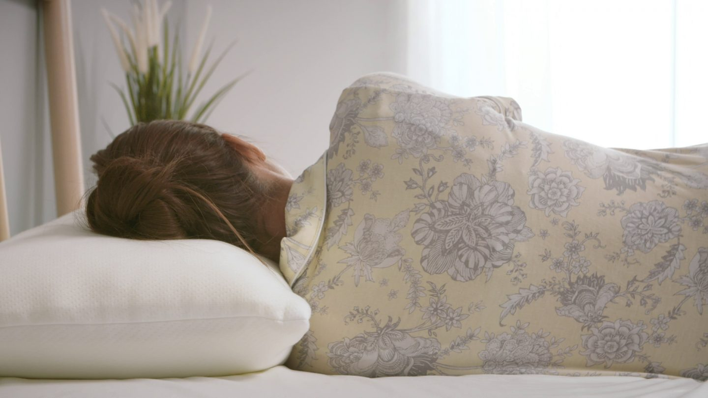 Woman sleeping with her head on a memory foam pillow